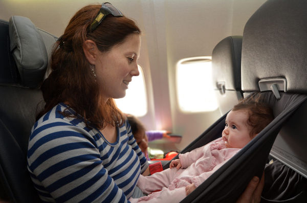 mum baby plane car seat cot