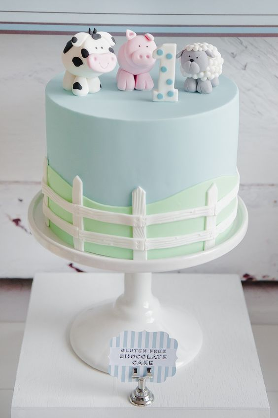 Farm Themed First Birthday Party Cake animal cake with fence