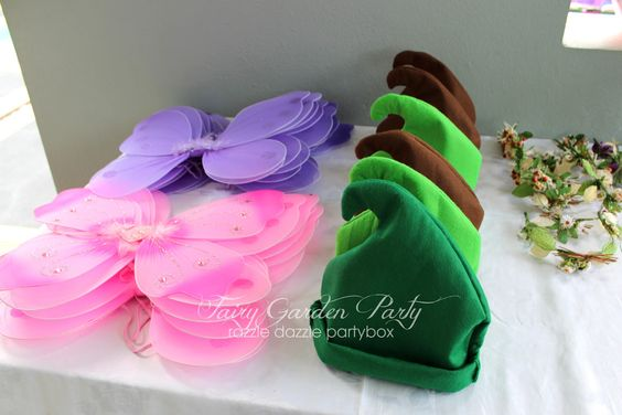 Garden Themed First Birthday Party Favour Ideas fairy wings and hats