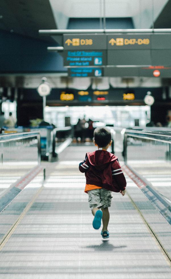 child running airport flying children
