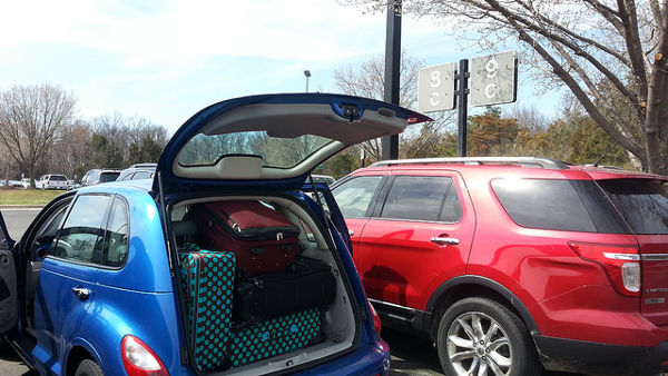 family car hire travel abroad suitcase car boot