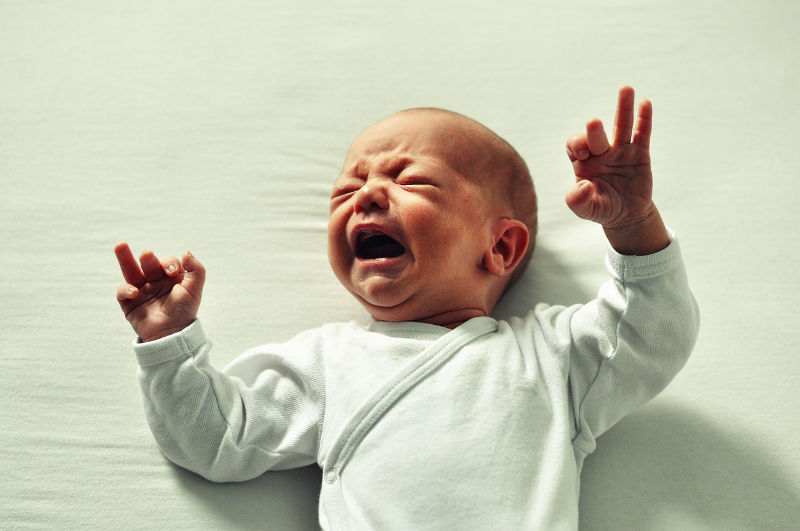 signs of tiredness newborn baby