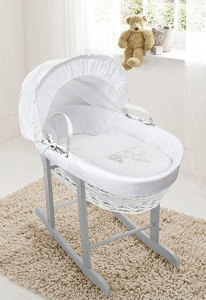 white teddy moses basket and rocking stand