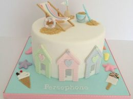 Seaside beach theme beach huts birthday cake