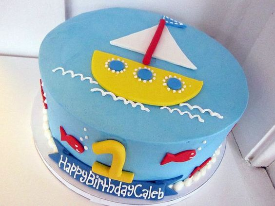Seaside beach theme sailing boat birthday cake