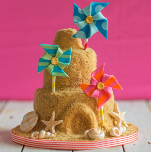 Seaside beach theme sandcastle birthday cake