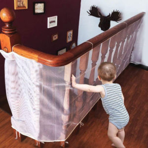 Child safety net for stair bannisters