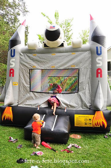Summer party ideas bouncy castle garden hire