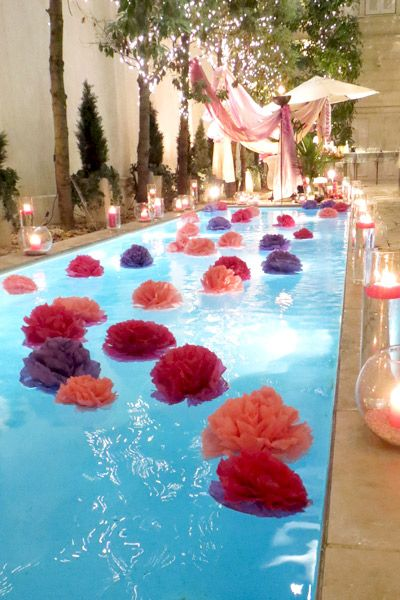 Summer party ideas pool floating flower decorations